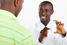 pharmacist give a medicine to a man