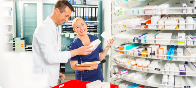 Pharmacist and her assistant holding a box